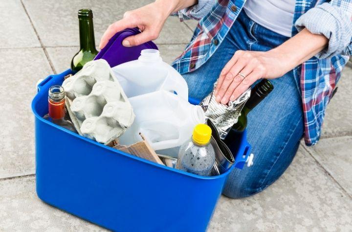 recycling bin with plastic milk jubs