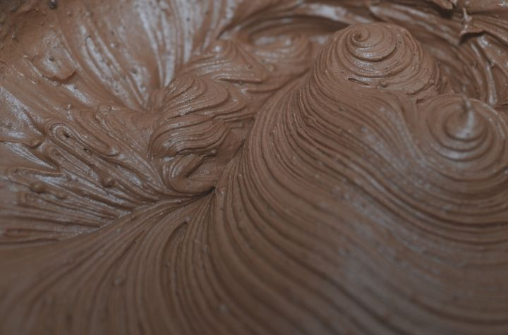 chocolate buttercream frosting in mixing bowl