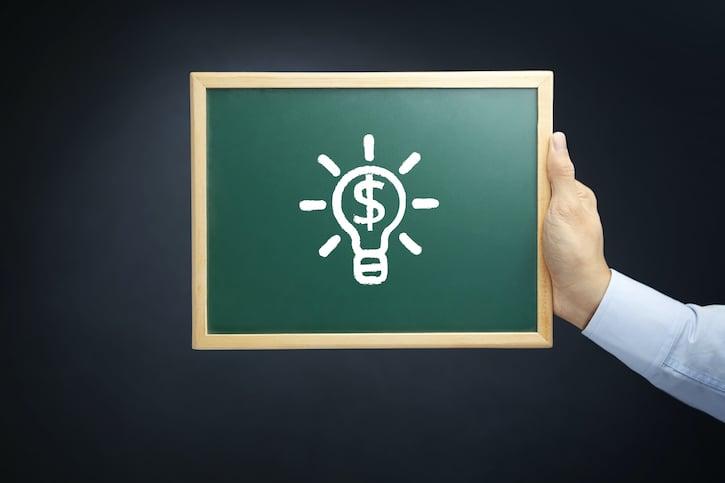 Light Bulb on Chalkboard with Dollar Sign