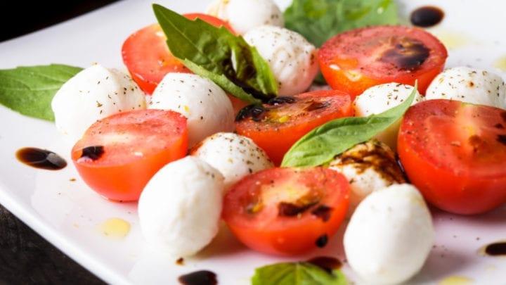 Caprese: cherry tomato, mozzarella balls and basil leaves