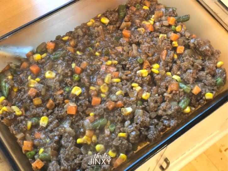 Hamburger Hashbrown Casserole Base mixture in glass baking dish