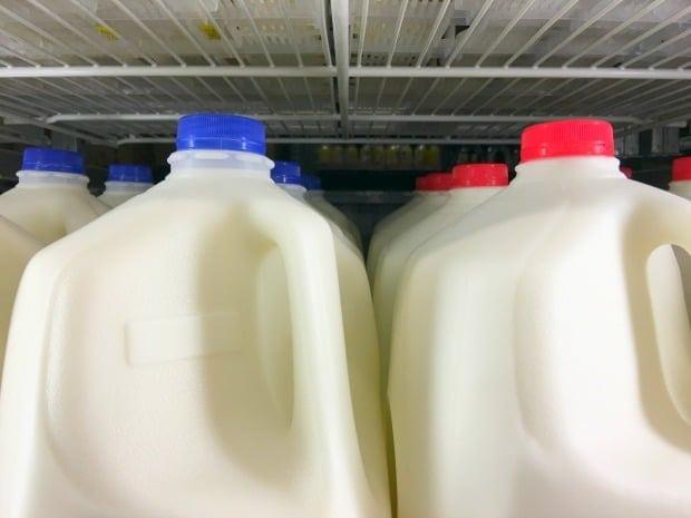 gallons of milk on shelf