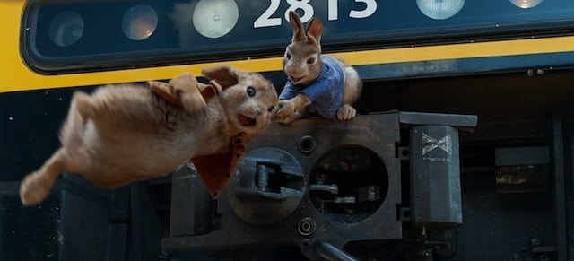 Peter Rabbit (James Corden) holds onto Benjamin (Colin Moody) in Columbia Pictures' PETER RABBIT.