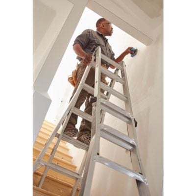 Man on Gorilla Ladder Indoors Preparing for Painting