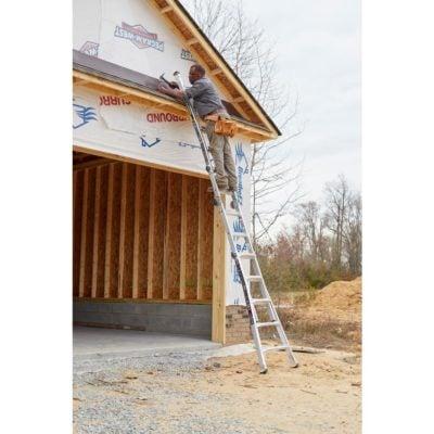 Man on Gorilla Ladder against Garage for Roofing Project