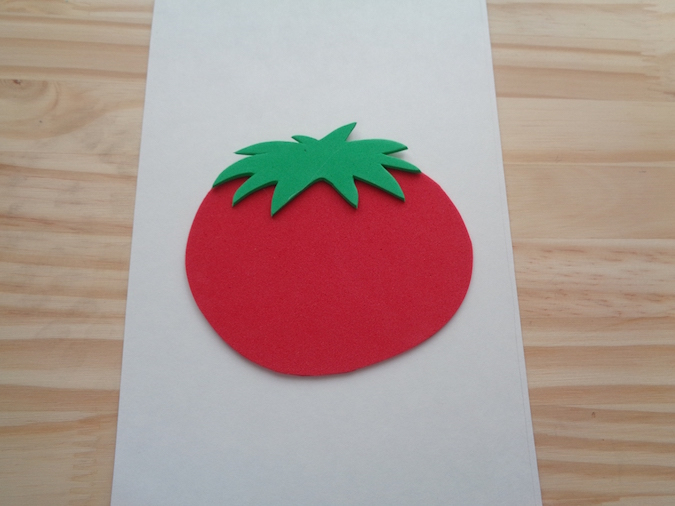 Red craft foam circle with green craft foam leaves