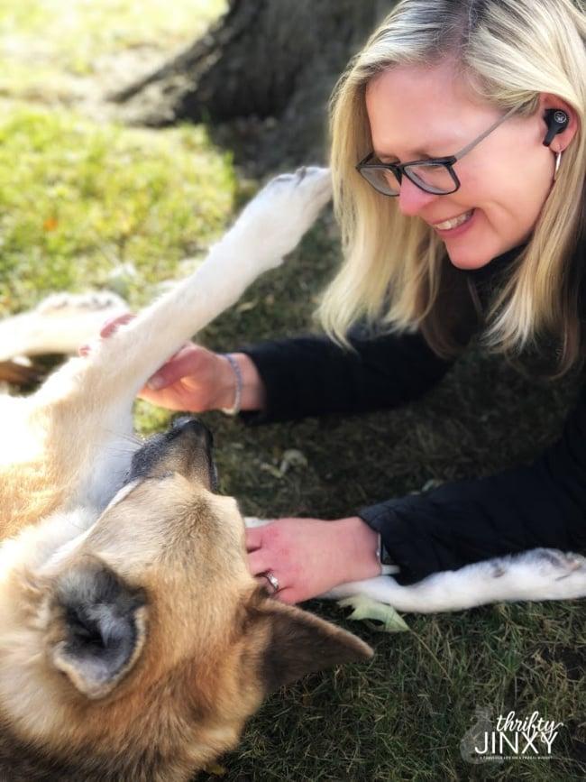 Woman and German Shepherd Dog Playing
