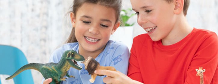 Children Playing with Schleich Dinosaur and Lion