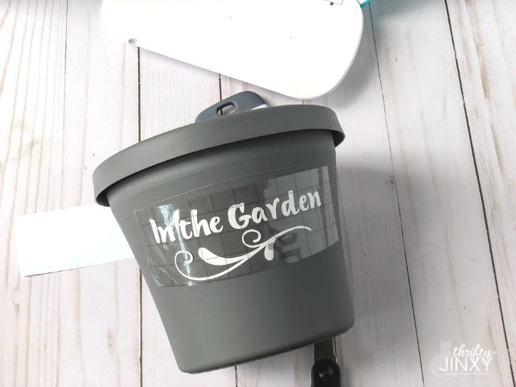 Applying transfer tape to flower pot