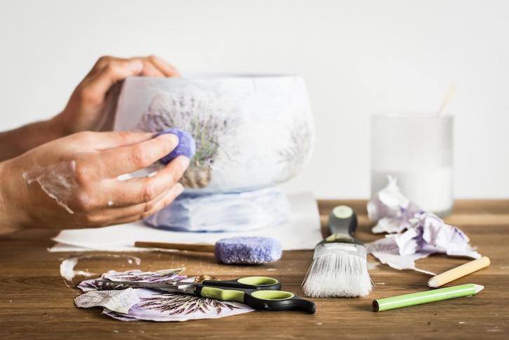 Hands Creating Decoupage on Glass Bowl