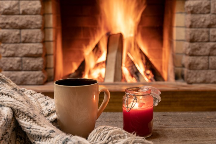 Cozy fall home setting with candle and mug