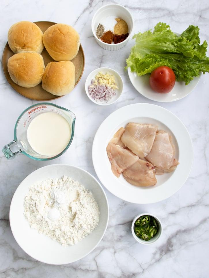 Crispy Fried Chicken Sandwich ingredients of chicken, buns, buttermilk, flour, seasoning, lettuce and tomato