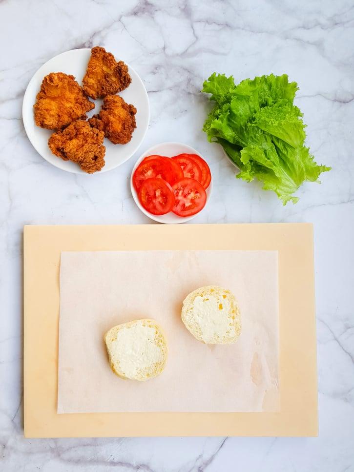 assembling Crispy Fried Chicken Sandwich