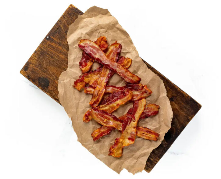 cooked bacon on brown paper