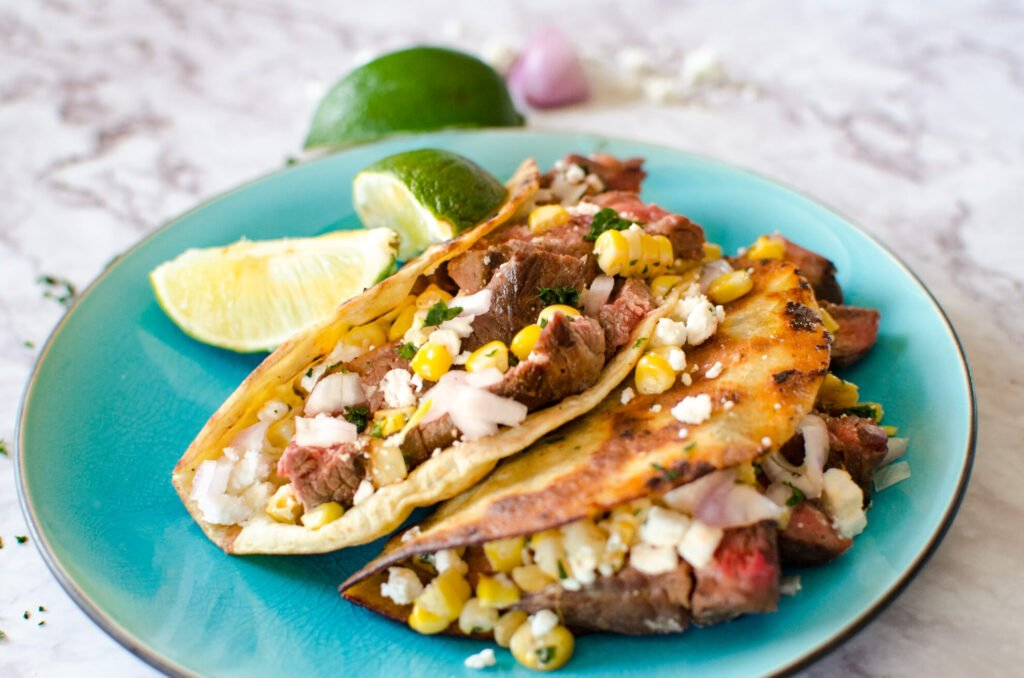 street tacos on a turquoise plate