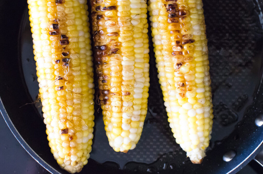 showing grill marks on ears of corn